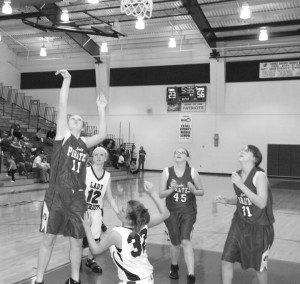 Makayla Moreland goes up for a shot as Mirand Miller (45) and Erika Tipton (31) look on in the Powell-Estill eighth grade game last week