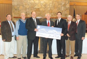 Gov. Steve Beshear (center) presented a check for $429,130 last Wednesday to Powell County officials for the construction of a welcome center at Slade. The new center will be built next to the rest area just off exit 33 of the Mountain Parkway. From left to right are Stanton Mayor Dale Allen, Magistrate Jim Dennis, Powell County Judge Executive Darren Farmer, Gov. Beshear, State Representative Richard Henderson, Clay City Mayor James Caudill and Powell County Economic Development Director Craig Dawson.