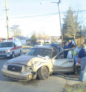 Powell County Ambulance crews assist Estill County Jailer James Morris after a two vehicle accident at the intersection of Washington Street and West Railroad Street in Stanton.