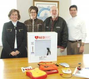 Powell Superintendent Evelyn Neely, schools health coordinator Laura Young, school board member David Griffin and safety coordinator Monroe Jones show of the new AED packages that are in the schools.