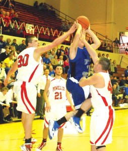 Powell's Jacob Conner (left) and Donovan Nolan (right) sandwich a Wolfe County player during last Saturday's game, as teammate Morgan Reed looks on. The Wolves won 76-70.