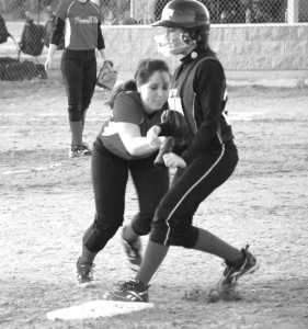 Powell County Lady Pirates Marie Covey tried to catch a Clark County runner off guard, but the runner beat her back to the bag in last week's game with the Lady Cardinals. Powell has been idle during the rainy weather, but look to play a lot this week as the forecast shows some improvement for the softball season.