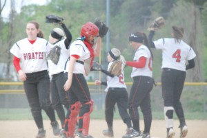 Times Photo by Kayla Mays-The Lady Pirates break from a huddle on the mound during last week's game against Jackson City. Though struggling some this season with a young team, the Lady Pirates have enjoyed some successes. They beat Jackon City 7-4 and this past Monday topped Owsley County 14-2 to improve to 2-1 in district play. They will host the Tanner Classic beginning tonight (Thursday) and running through Saturday. Powell will play Lee and Wolfe counties tonight.