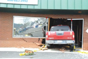 Medical emergency may have caused accident that damaged two businesses