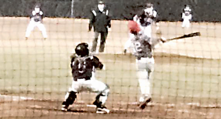 Photo by Tonya Lindon Powell's Mikey Lindon picks up a big hit in early season baseball action.