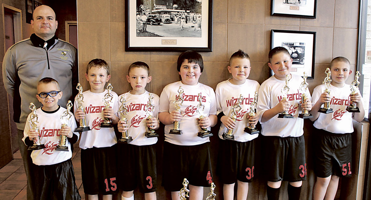 Photo by Stacy Crase The 2nd/3rd grade Wizards finished the season undefeated (10-0) and also won 1st place in the Little League Tournament! The team and coach are: (l to r) Coach Jimmy Crase, Kaleb Rose, Ben Fulks, Tristan West, Quentin Roberts, Braden Brandenburg, Austin Pierce and Colin Crase.