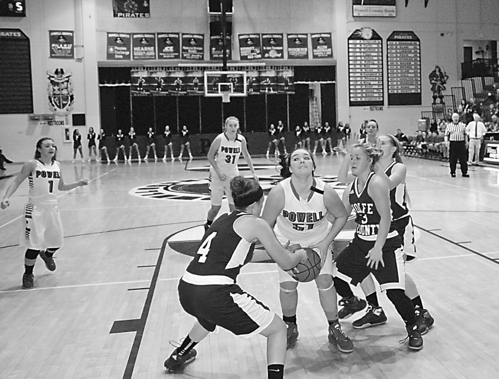Times Photo by James Cook Powell's Destiny Peck battled two Lady Wolves in the lane during last week's game. Peck scored 22 and grabbed 11 boards as Powell won, 45-41.