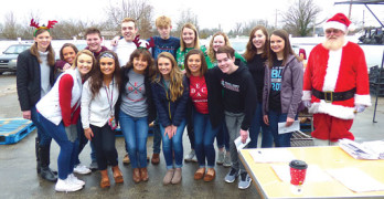 Volunteers distribute 300 Christmas meals to Powell County families